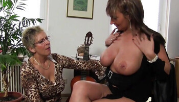 Granny with huge boobs fucks with a slutty lady